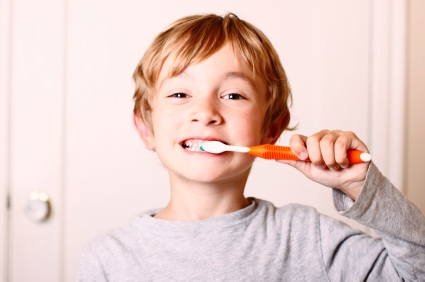 Wasilla, AK boy brushing his teeth before visiting the dentist.